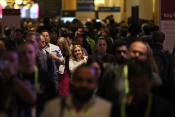 Attendees fill the halls at the Sands Expo and Convention Center during CES in Las Vegas, Tuesd ...