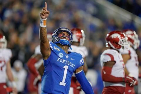 Kentucky quarterback Lynn Bowden Jr. (1) celebrates after throwing a touchdown pass during the ...
