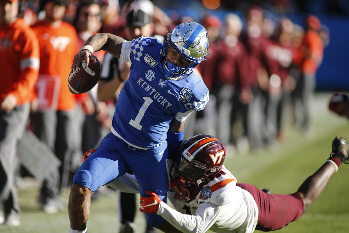 Kentucky quarterback Lynn Bowden Jr. (1) carries the football against Virginia Tech defensive b ...