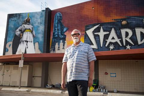 "Artist James Stanford stands in front of his mural, ""From the Land Beyond Beyond,&#x201d ..."