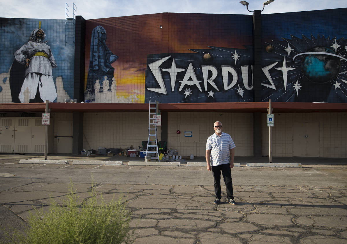 """Artist James Stanford stands in front of his mural, """"From the Land Beyond Beyond,&#x201d ..."""