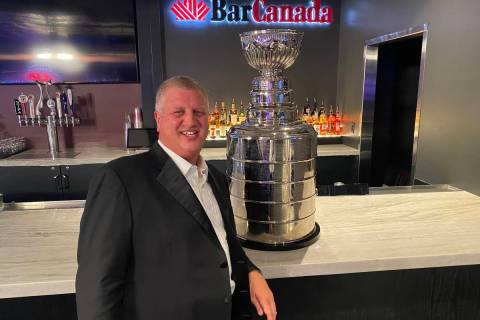 The D Las Vegas co-owner Derek Stevens poses with a replica Stanley Cup at BarCanada on Wednesd ...