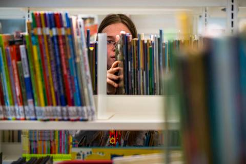 Rachel Hiatt shelves more kids books as work continues on the new East Las Vegas Library, Las V ...