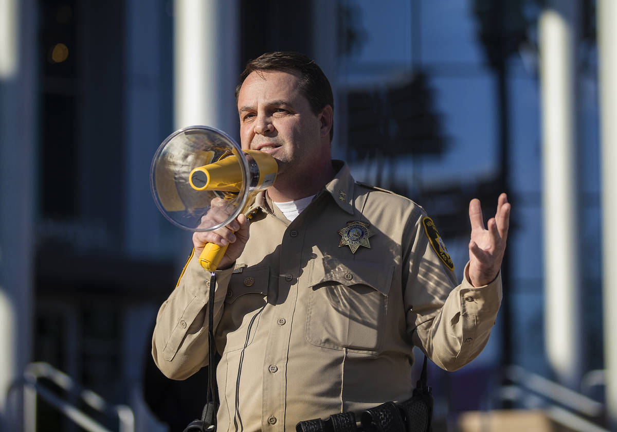Assistant sheriff Christopher Jones addresses a crowd of at least 300 protesters outside Las Ve ...