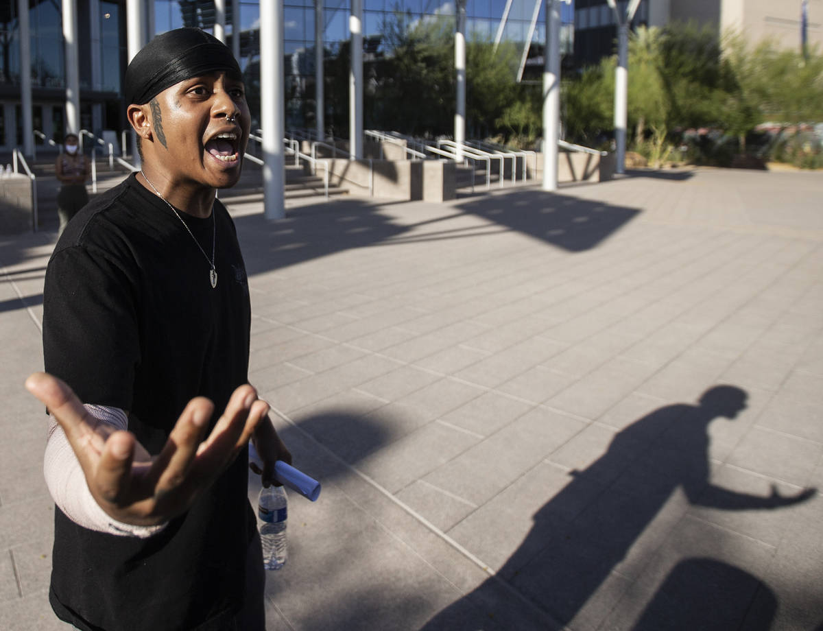 Prie Falaniko pleads for calm at a protest outside Las Vegas City Hall on Wednesday, June 3, 20 ...
