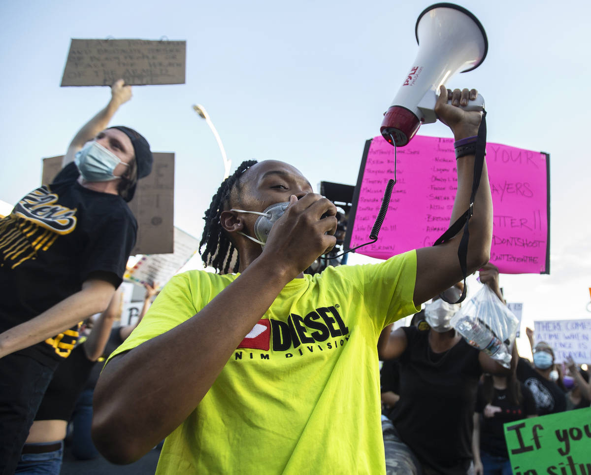 A crowd of at least 300 people protest outside Las Vegas City Hall on Wednesday, June 3, 2020, ...