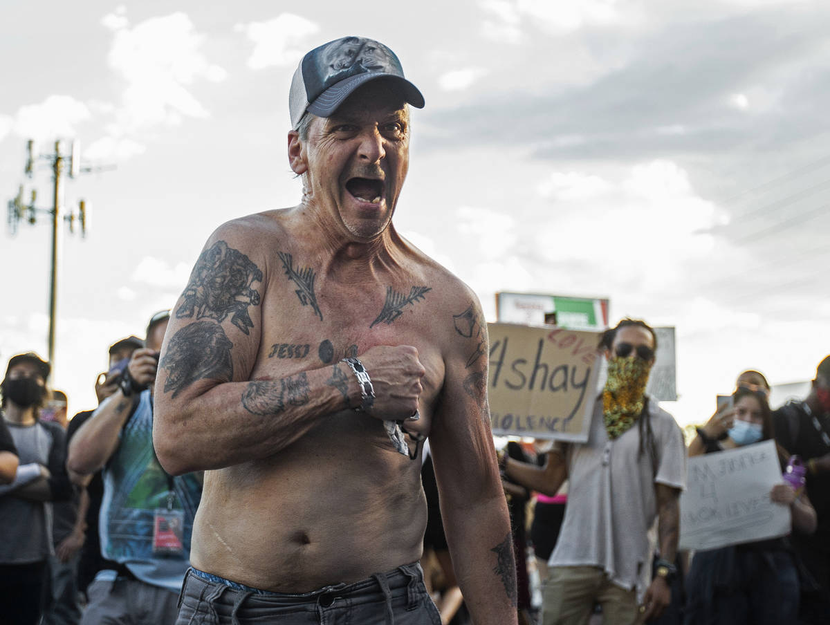 """An agitated man screaming """"my life matters"""" walks through hundreds of protesters outs ..."""