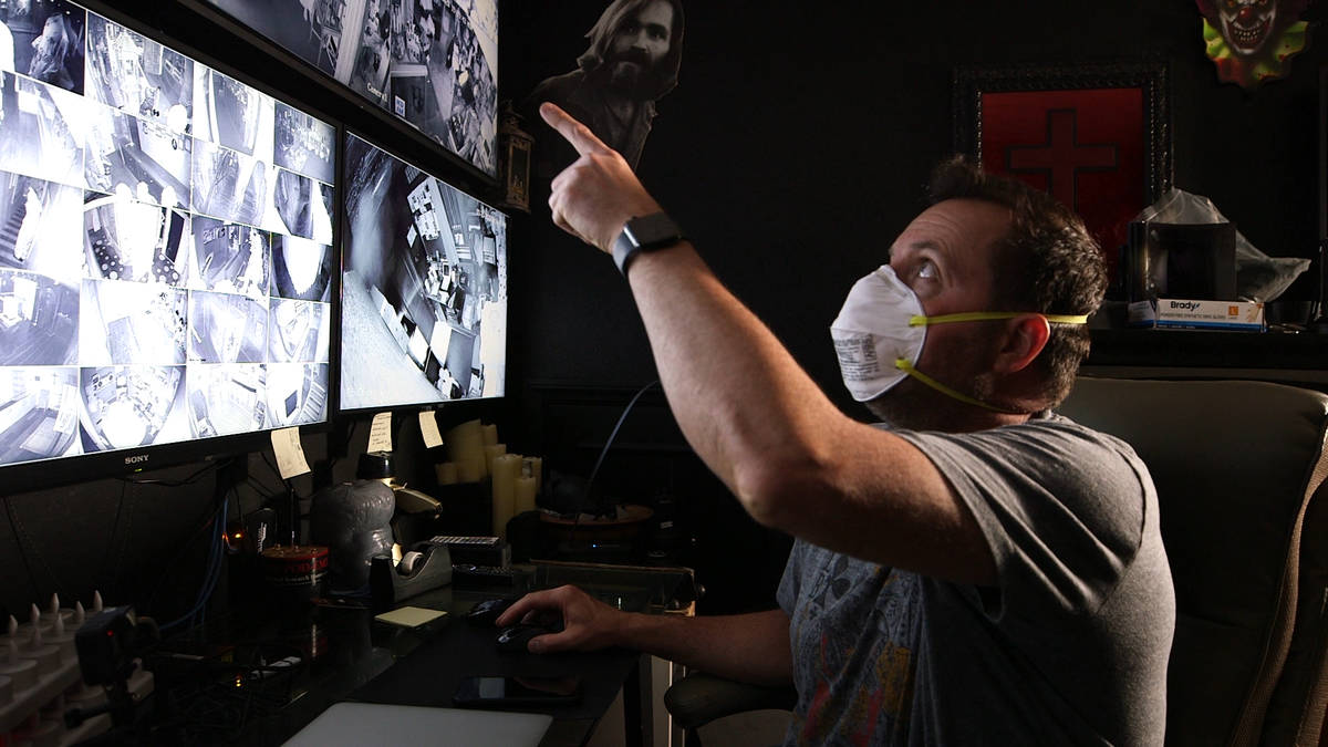 """Billy Tolley looks at video footage during the production of """"Ghost Adventures: Quarantine."""" (T ..."""