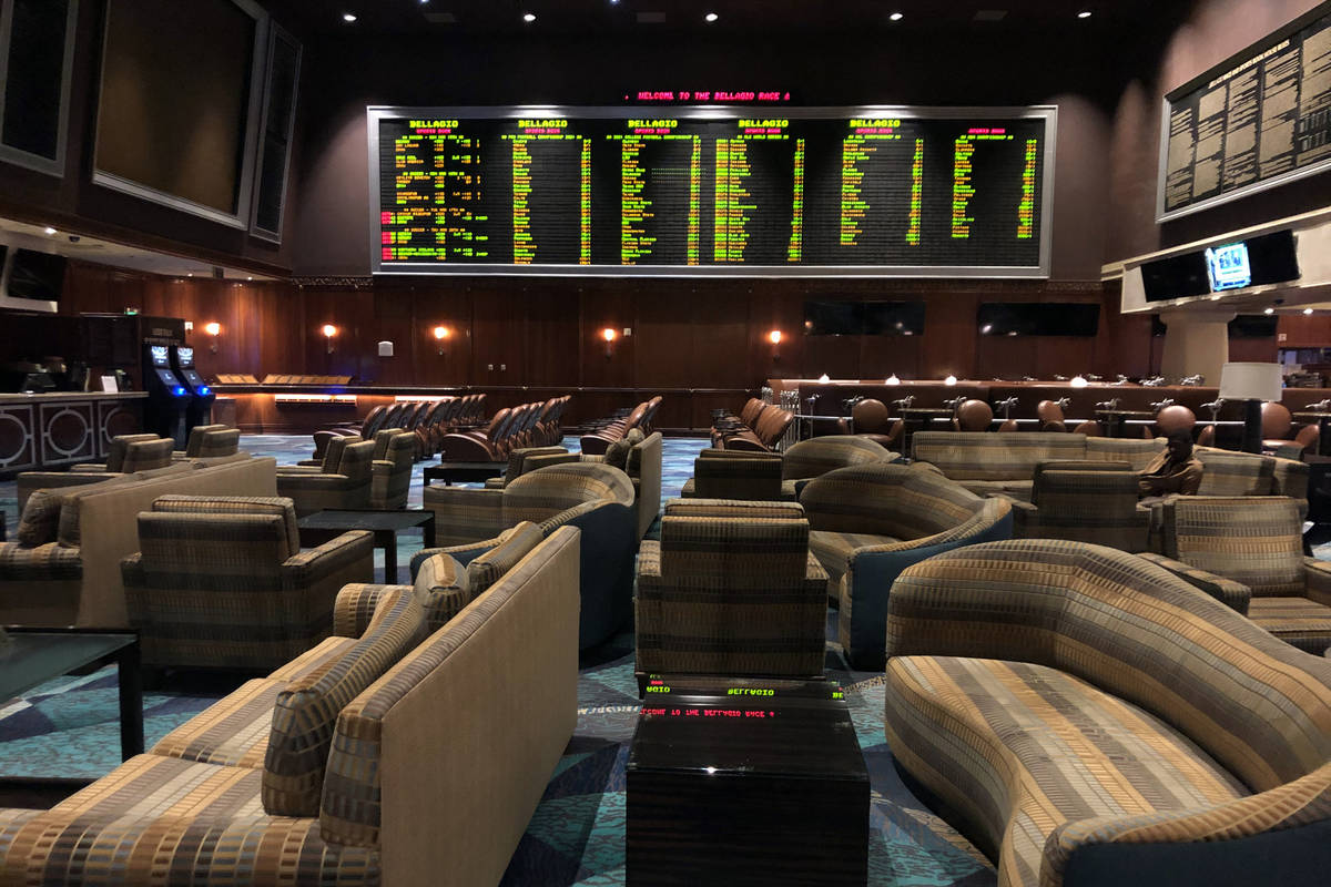 The sportsbook sits vacant within the Bellagio as MGM shuts down casino operations at midnight ...