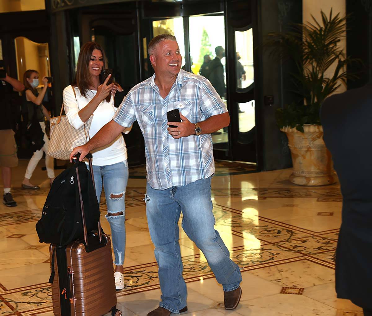 The first guests arrive at the Bellagio on the Strip in Las Vegas as the resort reopens after 7 ...