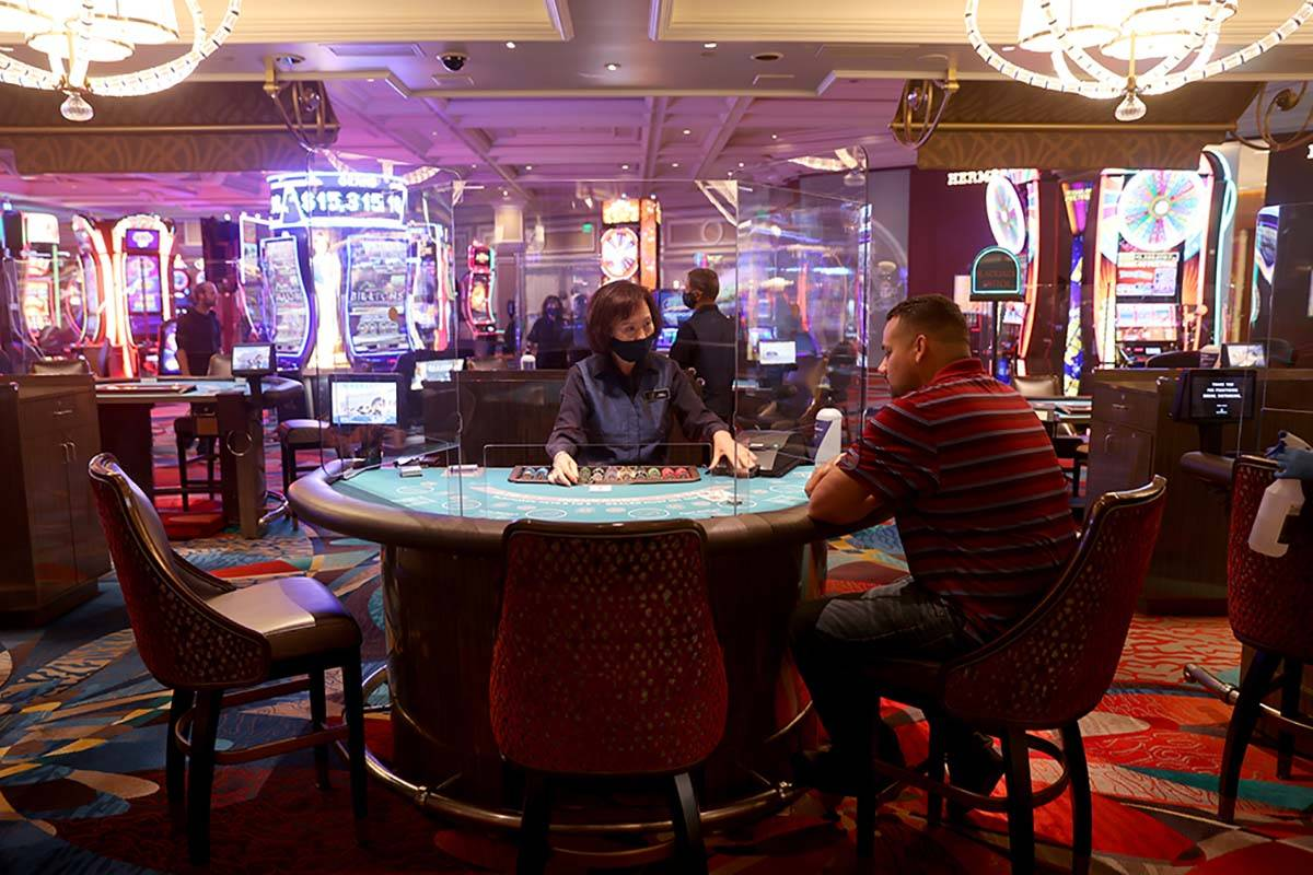 A guests plays blackjack at the Bellagio on the Strip in Las Vegas as the resort reopens after ...
