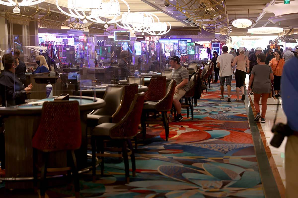 Guests play blackjack at the Bellagio on the Strip in Las Vegas as the resort reopens after 78 ...