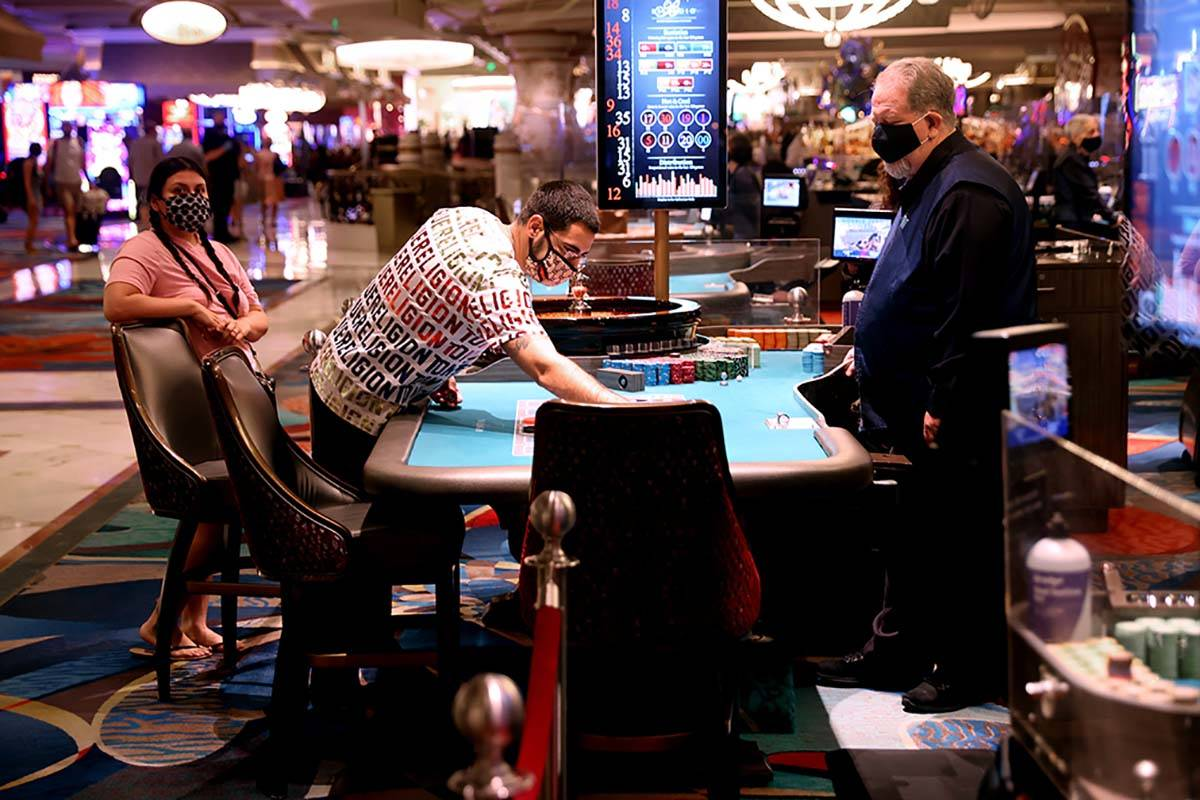 Guests play roulette at the Bellagio on the Strip in Las Vegas as the resort reopens after 78 d ...