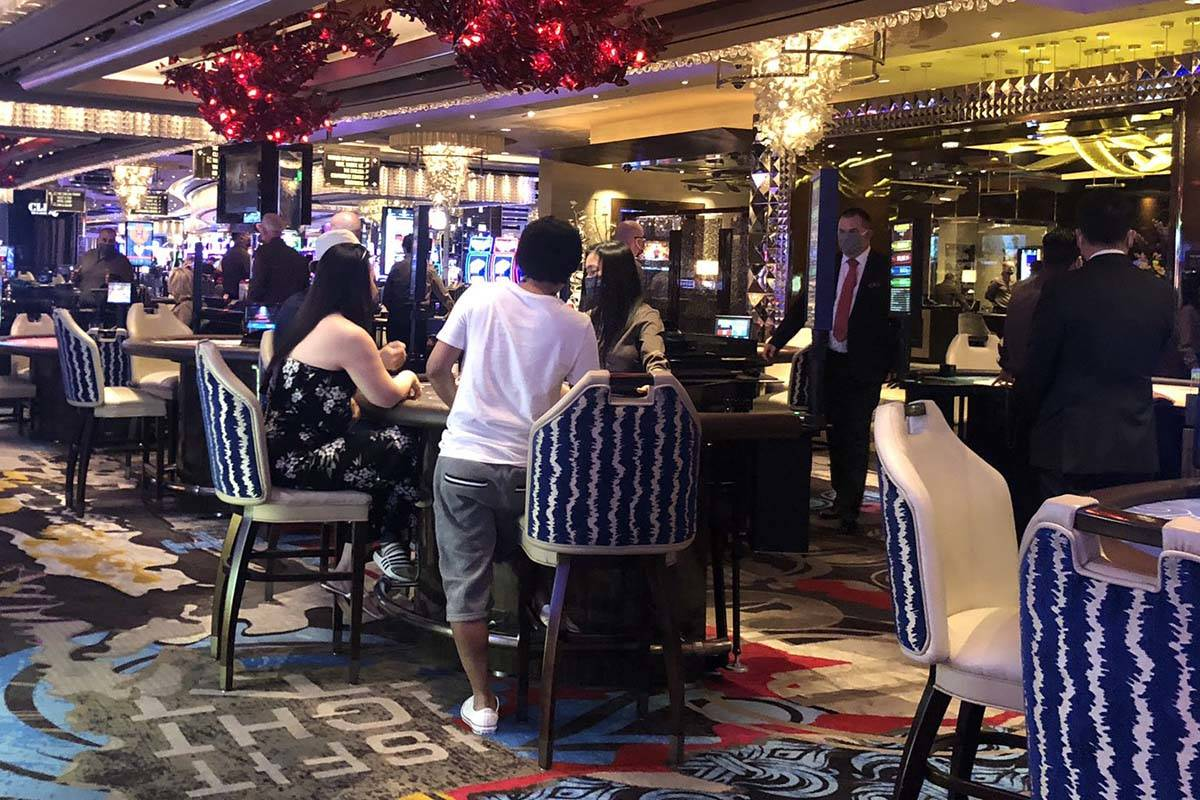 Gamblers sit three to a table at the Cosmopolitan on Thursday, June 4, 2020. (Briana Erickson/L ...