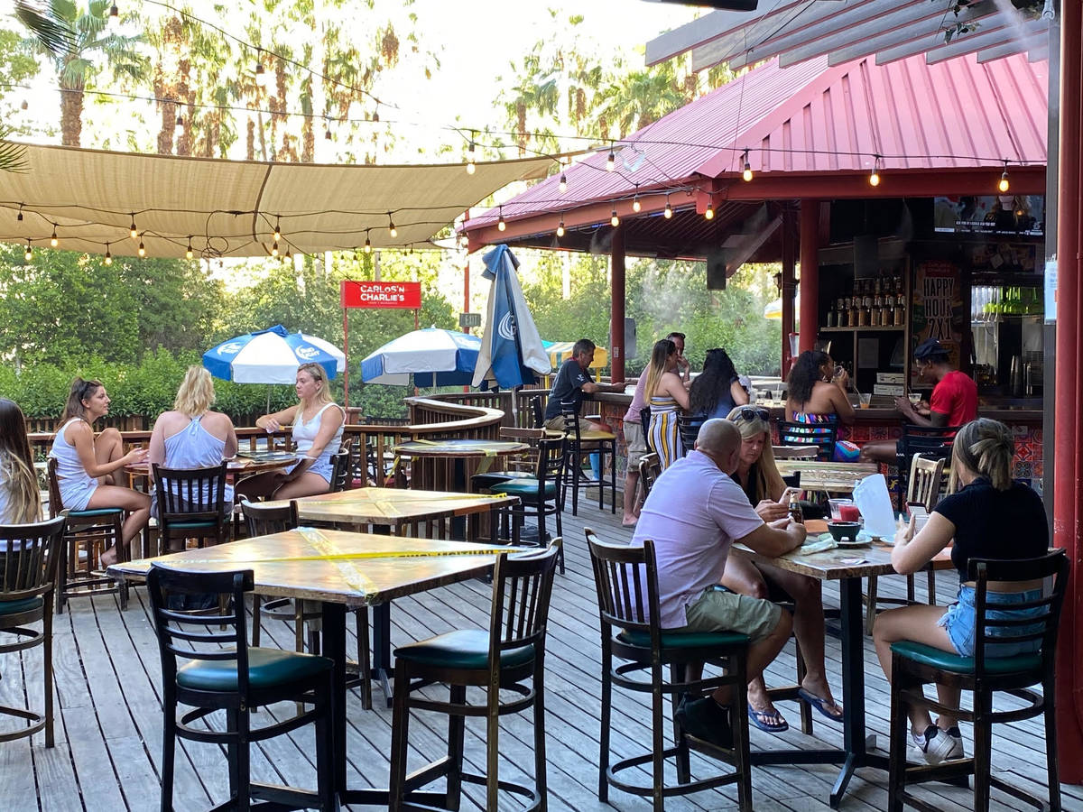 On the patio of Carlos 'N Charlie's Mexican restaurant at the Flamingo, diners enjoyed the ...
