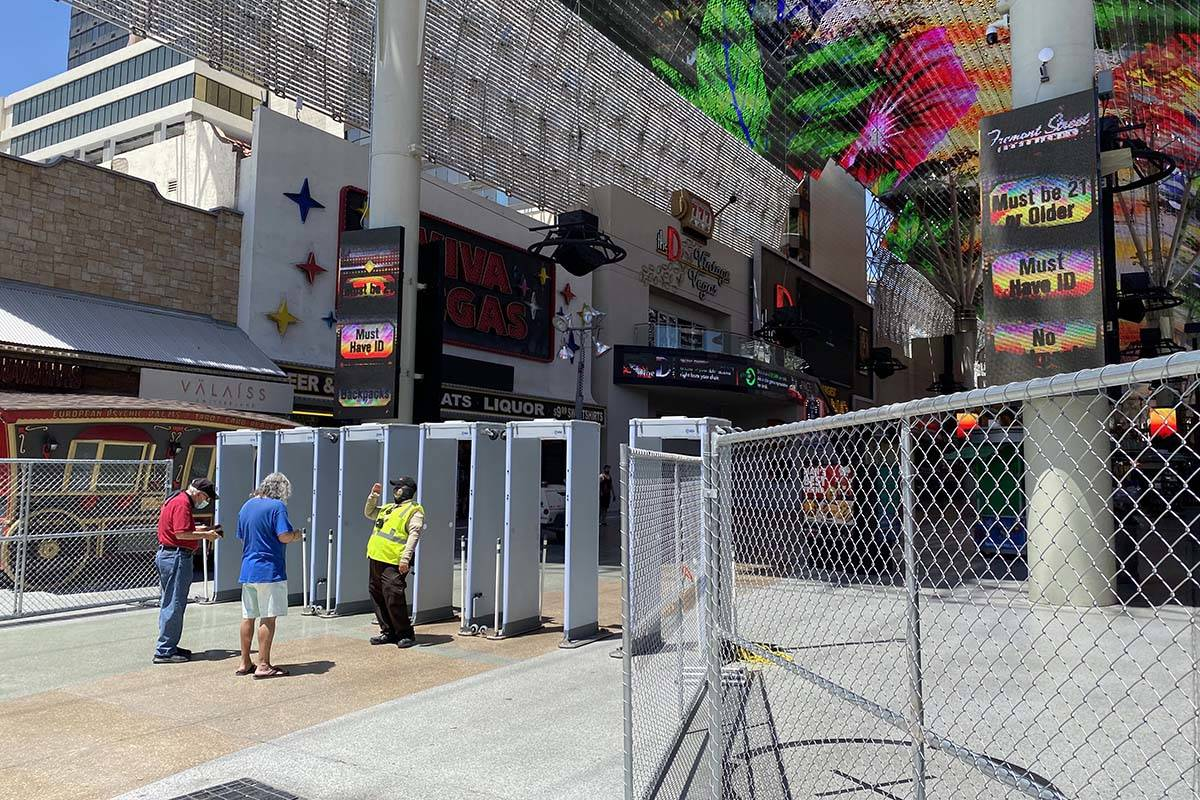 A security checkpoint at Fremont Street and Las Vegas Boulevard on Thursday, June 4, 2020. (Al ...