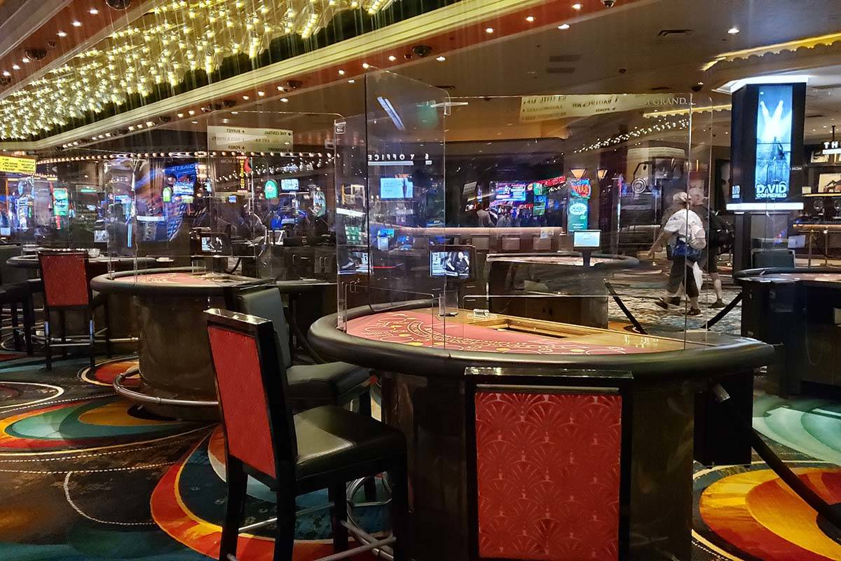 Glass partitions at gaming tables at the MGM Grand on Thursday, June 4, 2020. (Aleksandra Apple ...