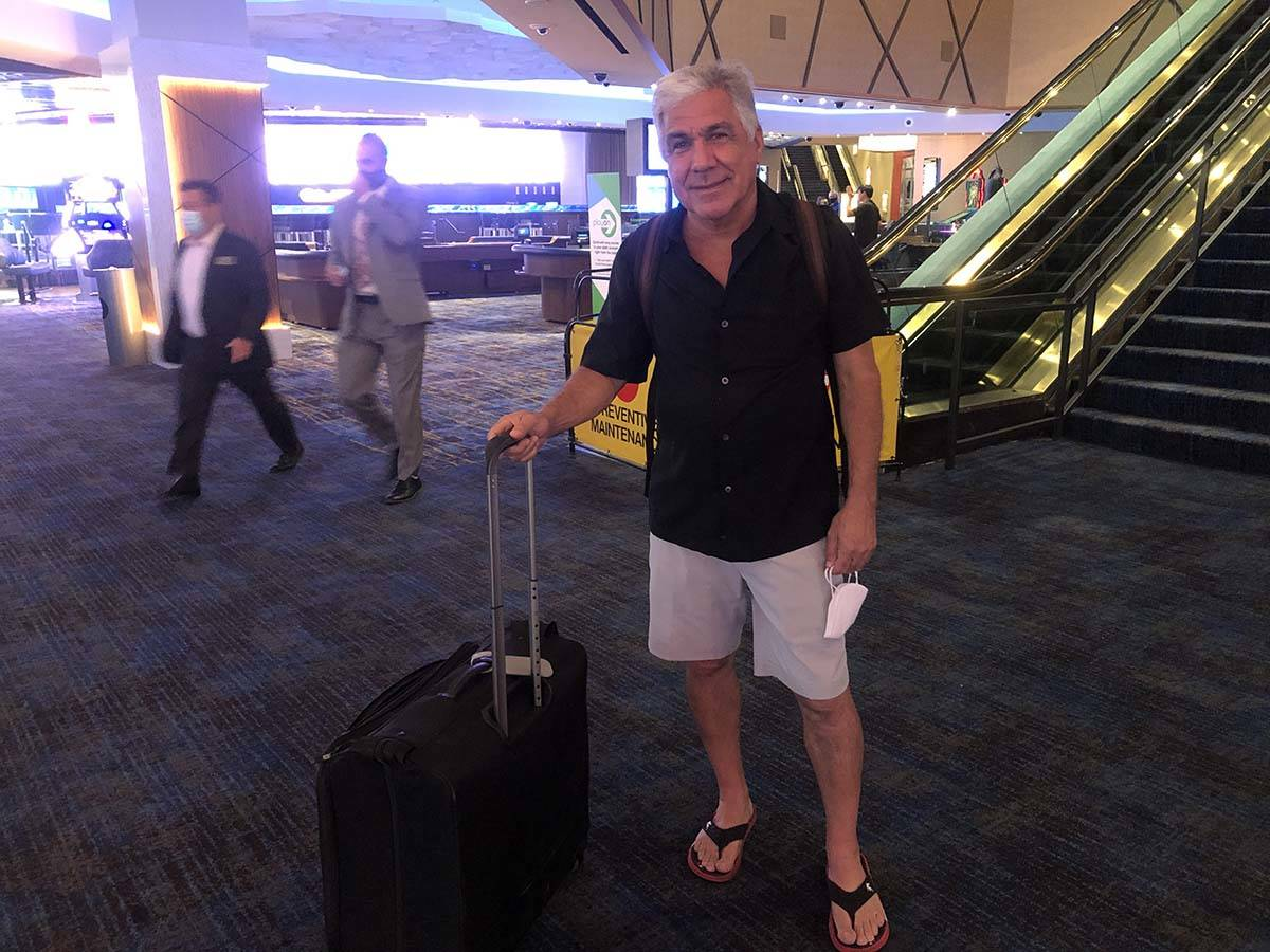 Drew Casen, from Henderson was waiting for doors to open at the Strat with a suitcase in hand. ...