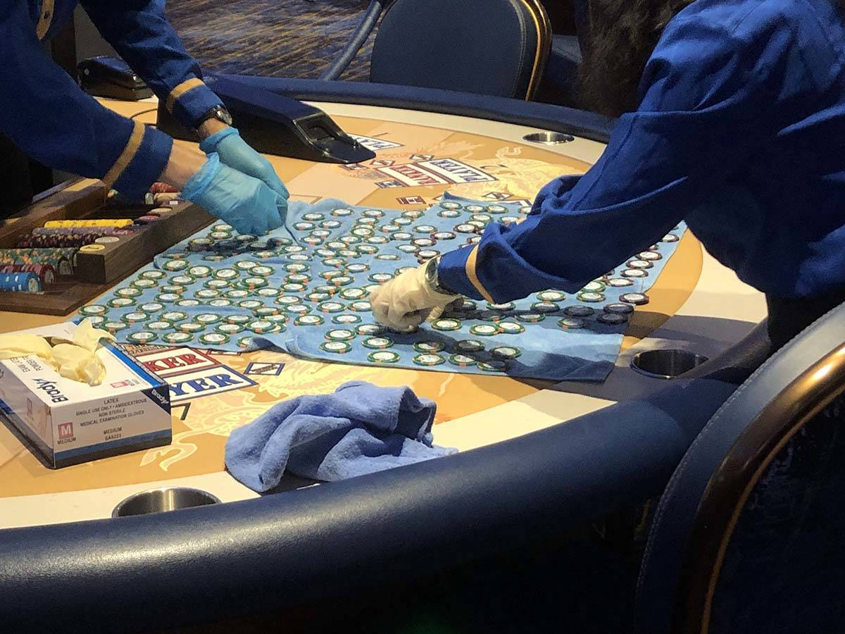 Workers at the Strat clean chips as the casino reopens on Thursday, June 4, 2020. (Katelyn Newb ...