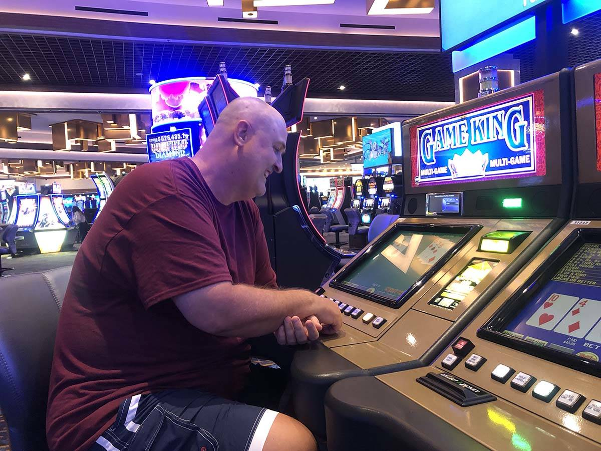 Winston Hausen sits at a video poker machine around 9:30 a.m. at the Strat on Thursday, June 4, ...
