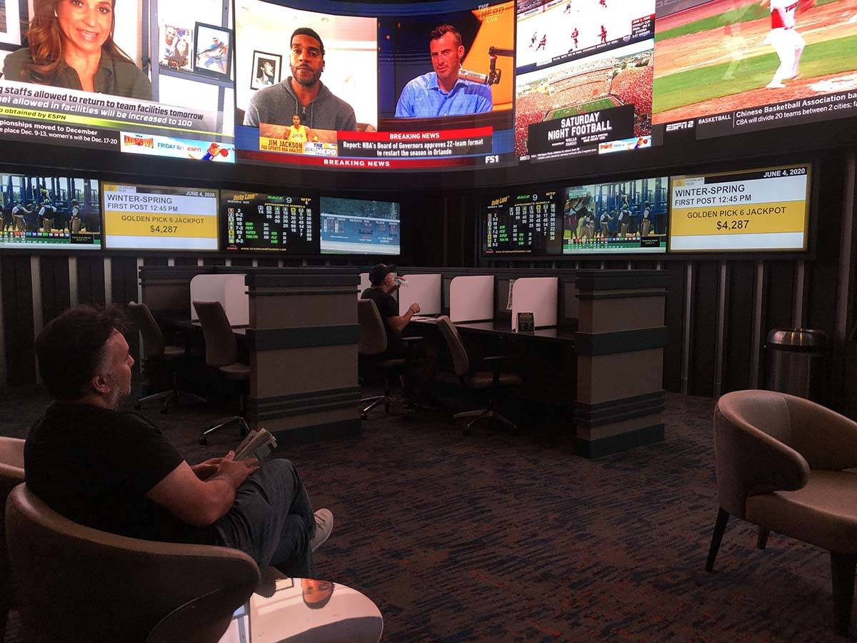 Dimitre Karabelas watches a horse race about 15 minutes after the Strat's sportsbook opened on ...