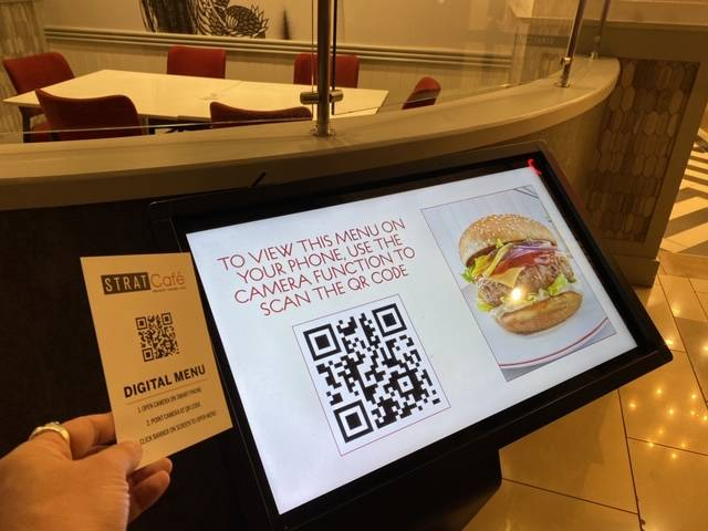 A touchless menu at The Strat Cafe, which was one of the few restaurants open on The Strat's ca ...