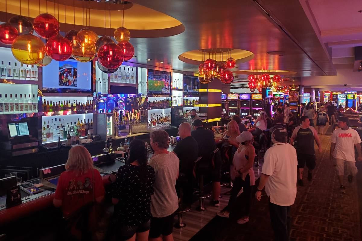 Visitors walk inside the Golden Nugget in downtown Las Vegas early Thursday, June 4, 2020. (Cha ...