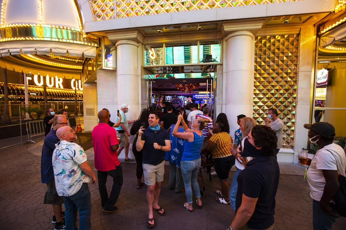 People enter the Golden Nugget just after midnight as hotel-casinos reopen in downtown Las Vega ...