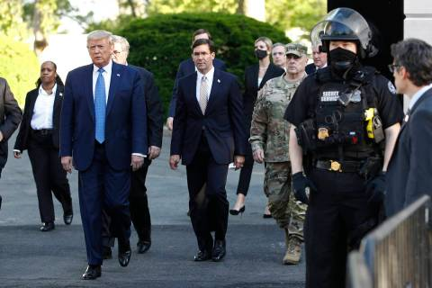 President Donald Trump departs the White House, accompanied by Secretary of Defense Mike Esper, ...