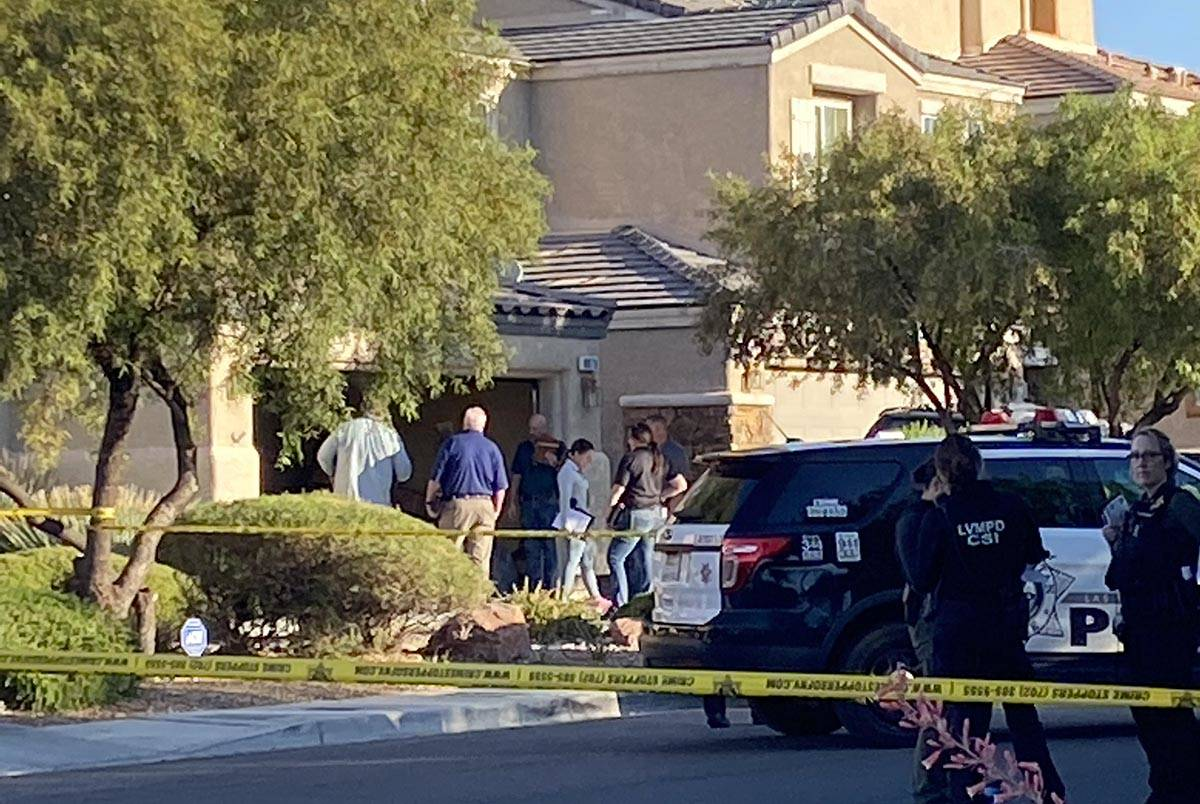 Las Vegas police officers investigate a homicide in the 8800 block of Canyon Saddle Drive in th ...
