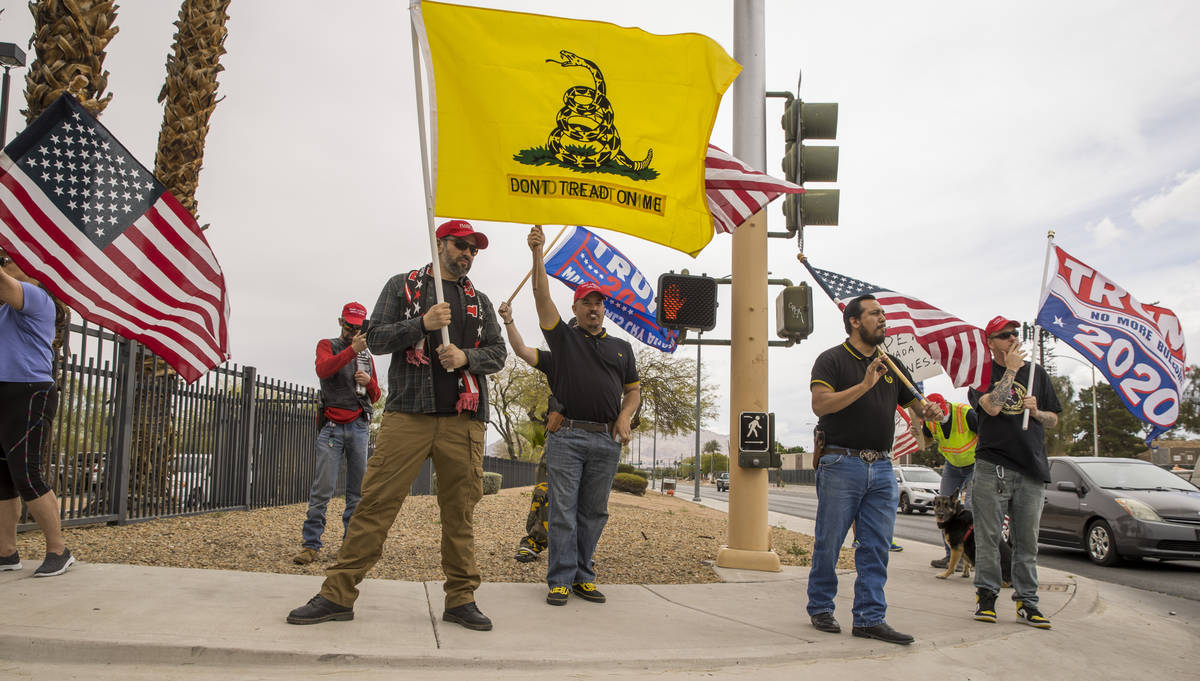 Proud Boys welcome all to enter as Reopen Nevada holds a protest at the Grant Sawyer State Offi ...