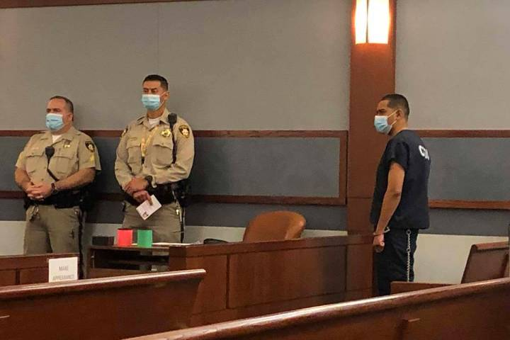 Edgar Samaniego, right, accused of shooting and critically wounding a Las Vegas police officer, ...