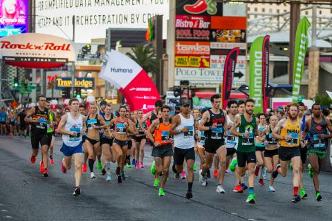 Elite runners leave the starting line during the Las Vegas Rock 'n' Roll Marathon along the Str ...