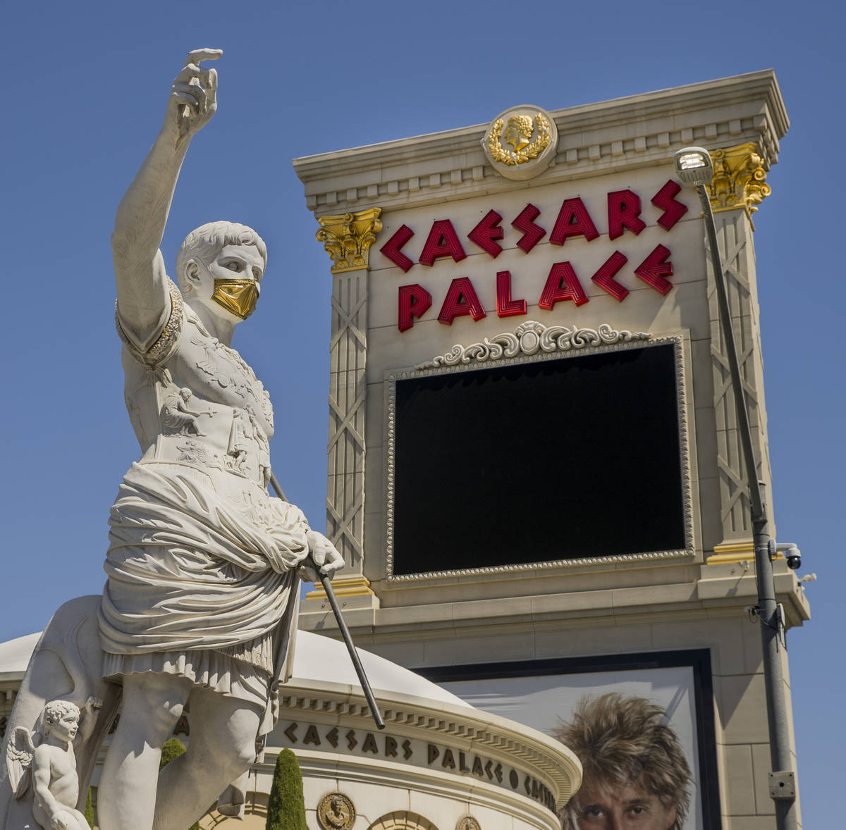 Caesar welcomes all out front while wearing a golden face mask following re-opening ceremonies ...