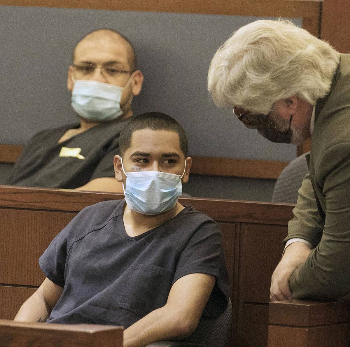 Edgar Samaniego, charged in shooting of Las Vegas police officer, listens to his defense attorn ...