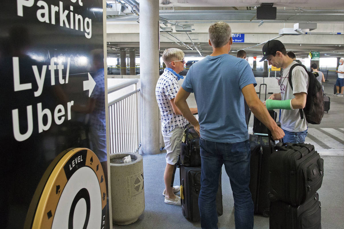 Arriving passengers wait for their ride at ride share waiting area at McCarran International Ai ...