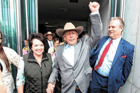 Cliven Bundy walks out of Lloyd George U.S. Courthouse in Las Vegas a free man with his wife Ca ...