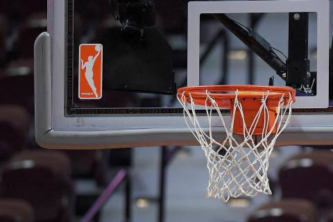 The WNBA logo and hoop are seen at a WNBA basketball game at Mohegan Sun Arena, Tuesday, May 14 ...