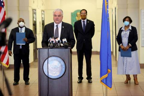 Gov. Steve Sisolak, second from left, speaks during a press conference with, from left, Assembl ...