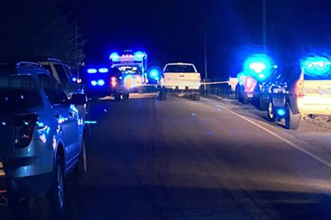 Police units respond to the scene where seven people were found shot to death inside a burning ...