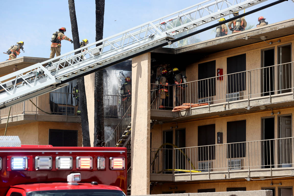 Las Vegas and Clark County firefighters battle a fire at Siegel Suites at 700 Las Vegas Blvd. N ...