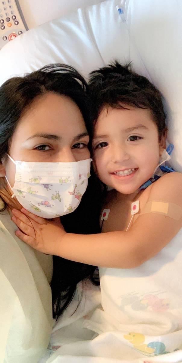 Karen Sombra cuddles Thursday with son Sebastian Rodriguez in the intensive care unit at Sunris ...