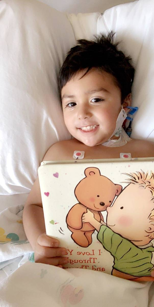 Sebastian Rodriguez smiles from his bed in the intensive care unit at Sunrise Children's Hospit ...