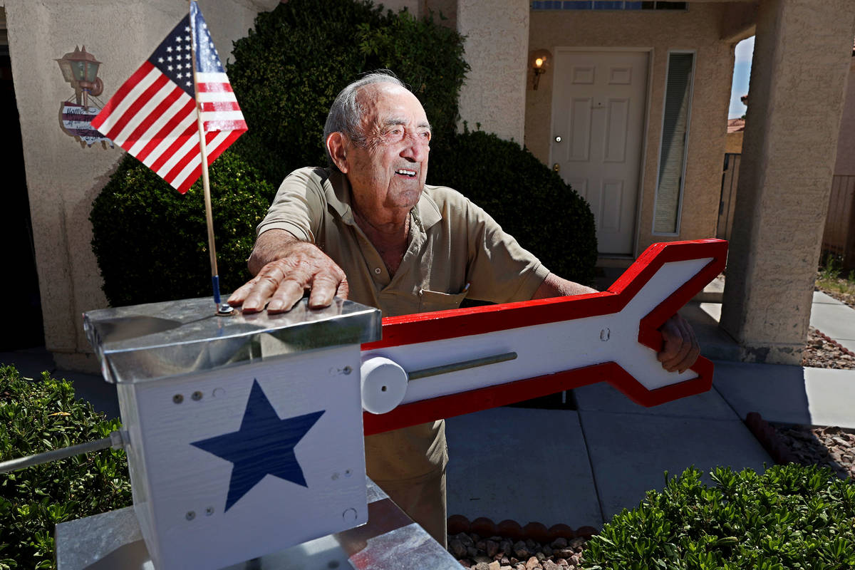 "Onofrio ""No-No"" Zicari, 97, a World War II veteran, poses in front of a windmill his ..."