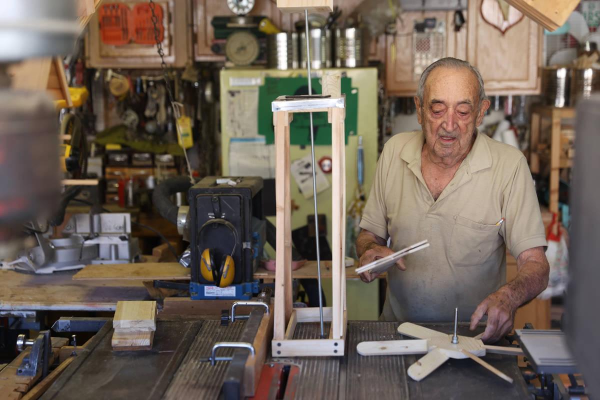 "Onofrio ""No-No"" Zicari, 97, a World War II veteran, works in his wood workshop at his ..."