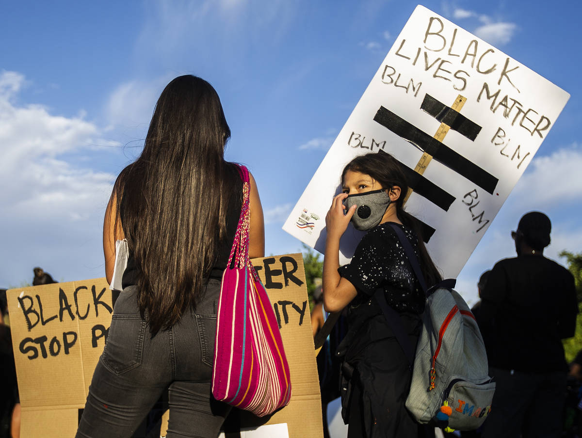 Maya Hernandez, right, 10, and Melissa Sparza listen to a speaker at a Black Lives Matter event ...