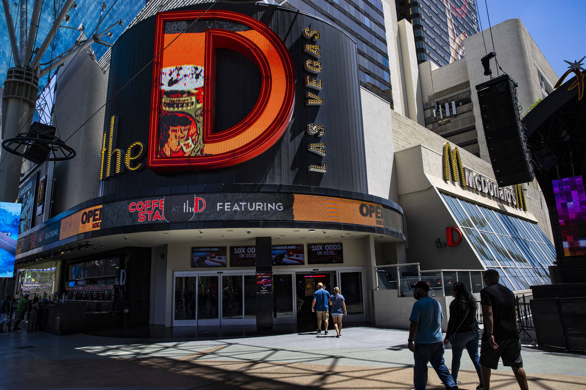 People walk outside of the D Las Vegas at the Fremont Street Experience in downtown Las Vegas o ...