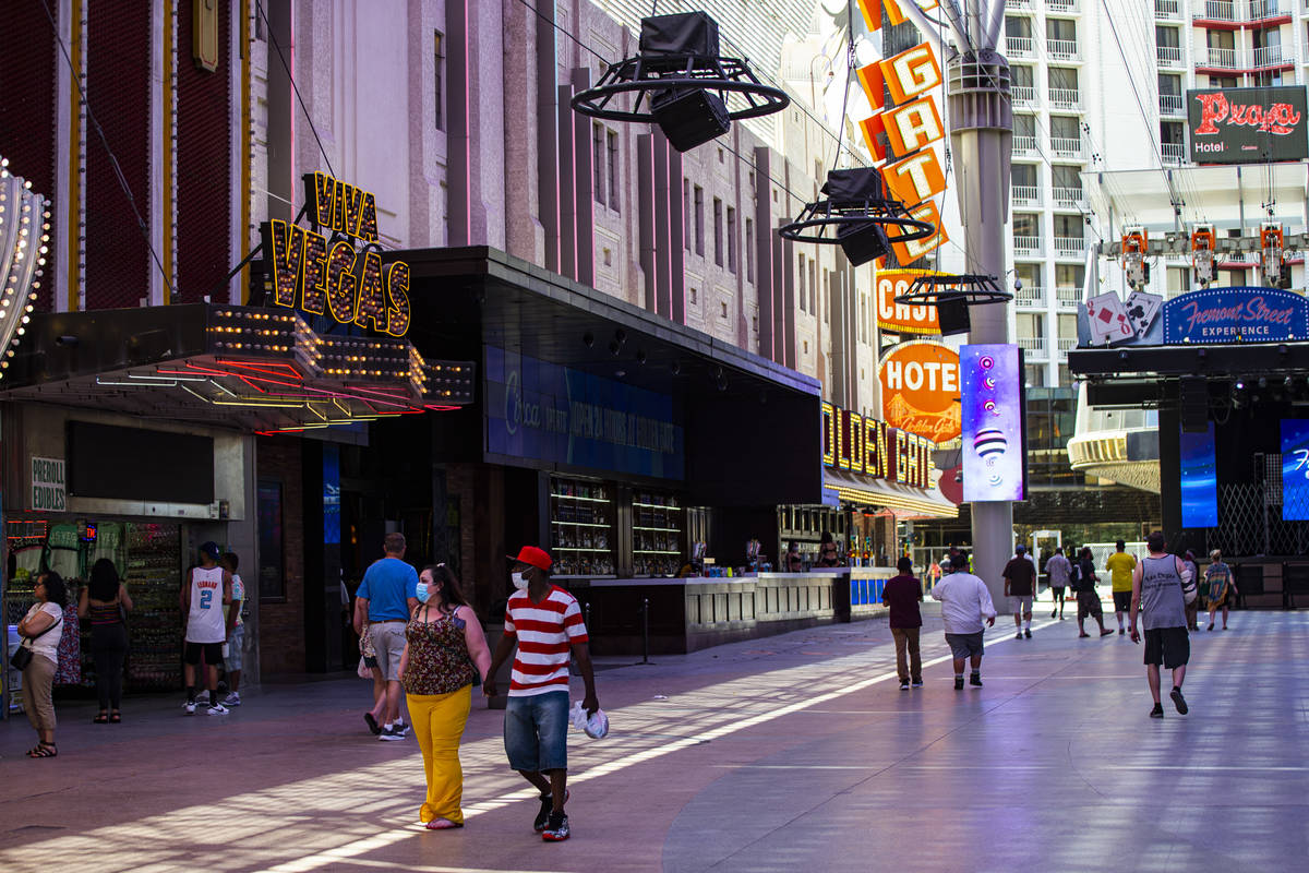 People walk around the Fremont Street Experience in downtown Las Vegas on Saturday, June 6, 202 ...