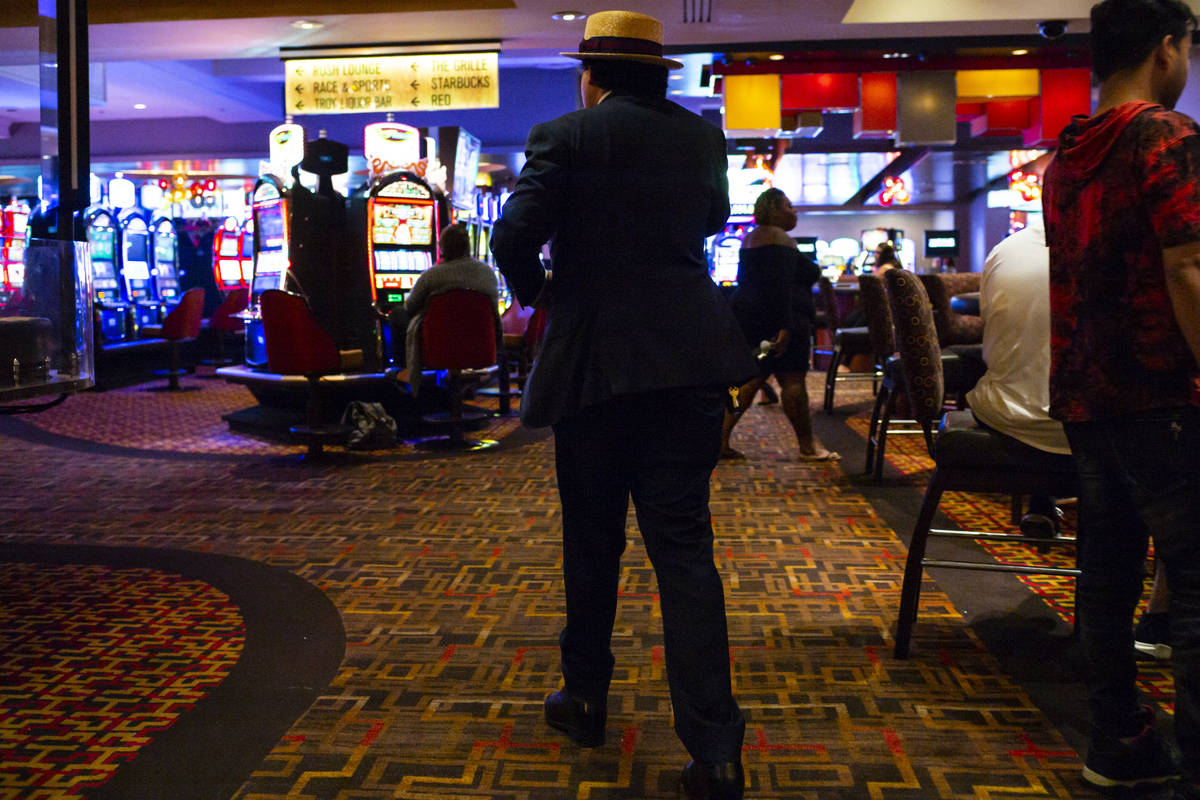 A man walks through the Golden Nugget just before 3 a.m. as hotel-casinos reopen in downtown La ...
