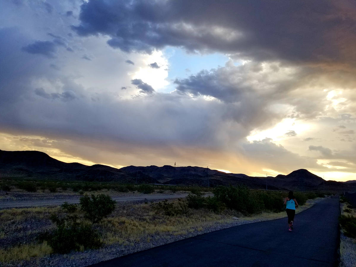 A runner hits the Burkholder Trail pavement in the early morning of June 3. (Natalie Burt)